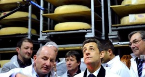 Image: Nicolas Sarkozy, France's President and UMP candidate for the 2012 Presidential Election, visits a cheese factory in Vallieres in the French Alps